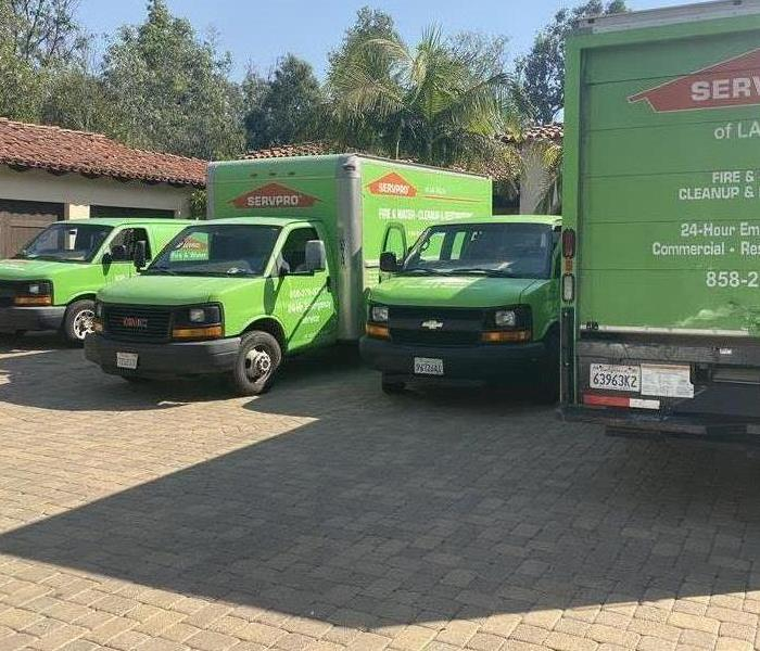 four lime green vehicles in driveway